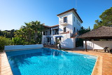 Traditional style white Spanish villa and pool