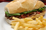^ Steak and peppers sandwich with fries