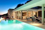 Luxury modern white villa and pool at sunset in Ibiza