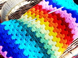 Bright-colored crocheted afghan