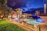 Amalfi coast luxury villa, garden and pool at night