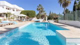 Luxury white villa, pool, and tennis court in Ibiza