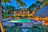 Luxury Villa and pool in tortuga bay at dusk