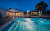 Rural luxury farmhouse villa and pool at night