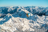 Hot Air Balloon in Snow-Covered Mountains