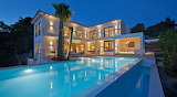 Luxury white villa and pool at dusk in Mallorca