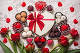 ^ Valentine's Day candy and red tulips