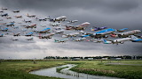 ^ Composite of planes taking off