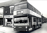 Double-decker bus parked down Ashby High Street
