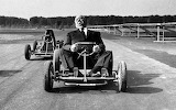 Alfred Hitchcock riding a kart, 1960
