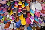 Dozens of colorful traditional slippers