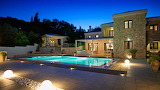 Modern stone Mediterranean house and pool at night