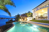Luxury ocean view home and pool at night
