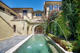 Mediterranean style luxury home, courtyard and pool