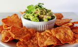 ^ Zesty Cheddar Roasted Veggie Tortilla Chips & Guacamole
