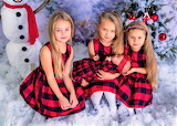 Four sisters in Christmas dresses