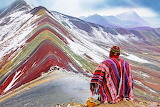 Sitting man admires the mountain of seven colors