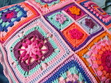 Granny square pillow in pinks