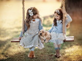 Girls on a swing with dog
