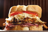 ^ Meat, provolone, fries, cole slaw, tomatoes and italian bread