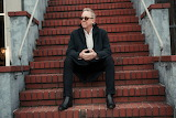 Boz Scaggs on stairs