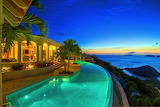 Luxury sea view villa and pool at sunset
