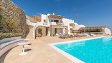 Modern luxury stone and white Greek villa and pool